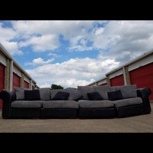 Black and suede sectional couch
